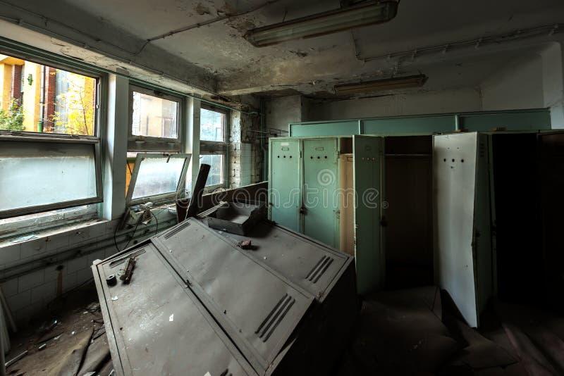 Dark room with steel lockers. Inside angle shot royalty free stock photo