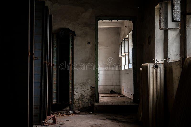 Dark room with steel lockers. Inside closeup royalty free stock image