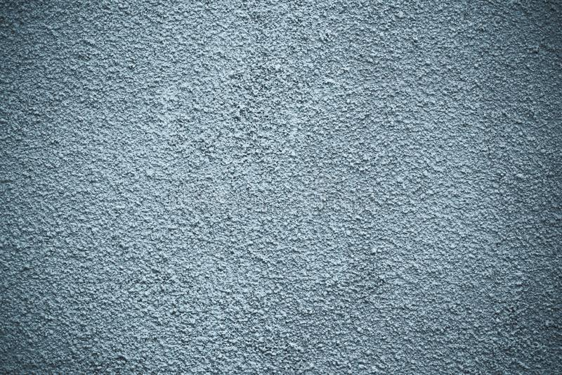 Dark rough concrete wall. Abstract gray pattern, architecture background. Black dirty stone texture. Grunge, blue stucco surface w royalty free stock images