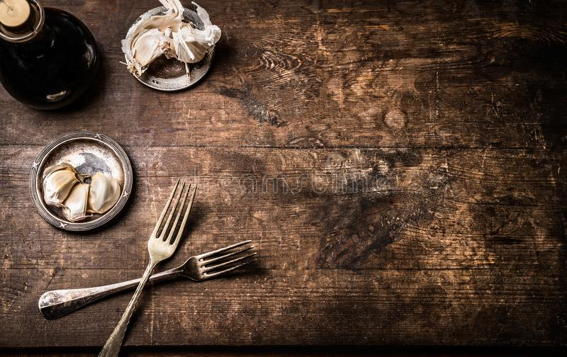Dark rustic aged wooden food background with cutlery and seasoning, top view with copy space for your design,recipes,menu stock photography