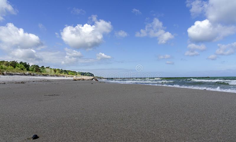 Dark sandy beach royalty free stock image