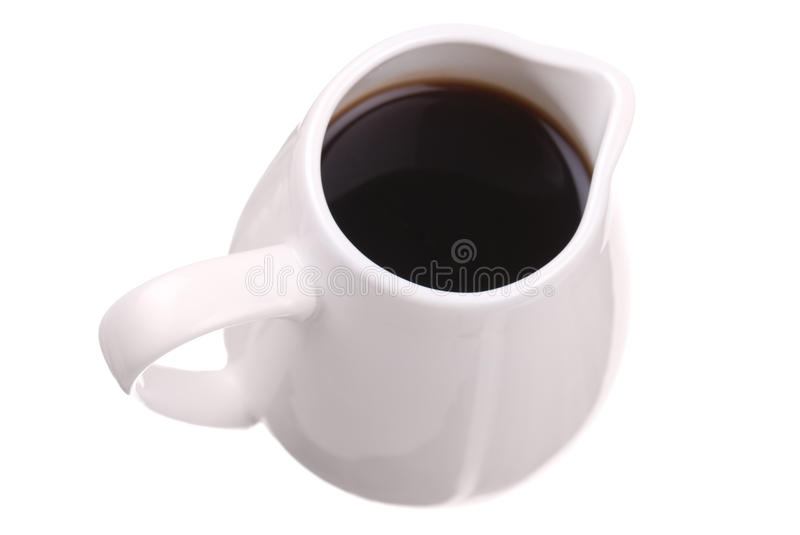 Dark sauce in white saucer royalty free stock images