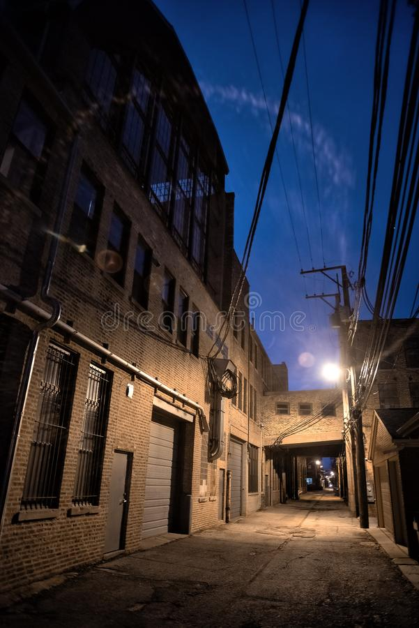 Dark and scary downtown urban city street alley scene at night royalty free stock photos