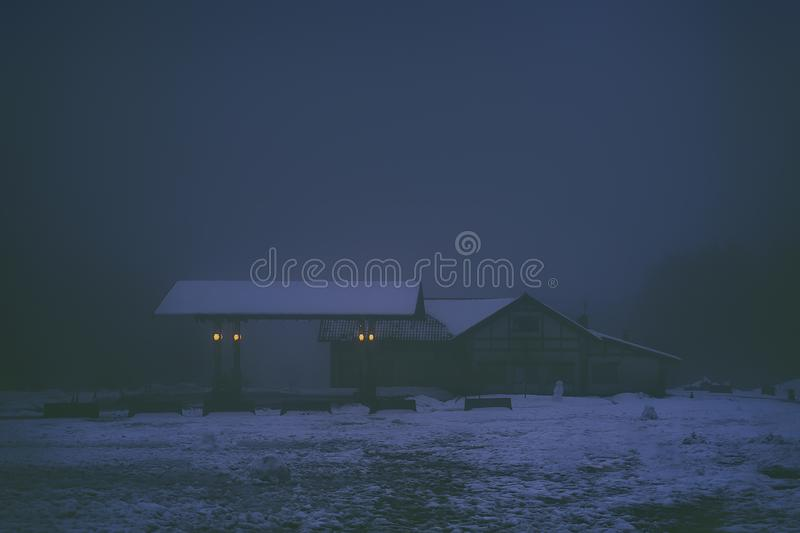 Scary old gas station and house at night. Dark scary old gas station and house at night royalty free stock images