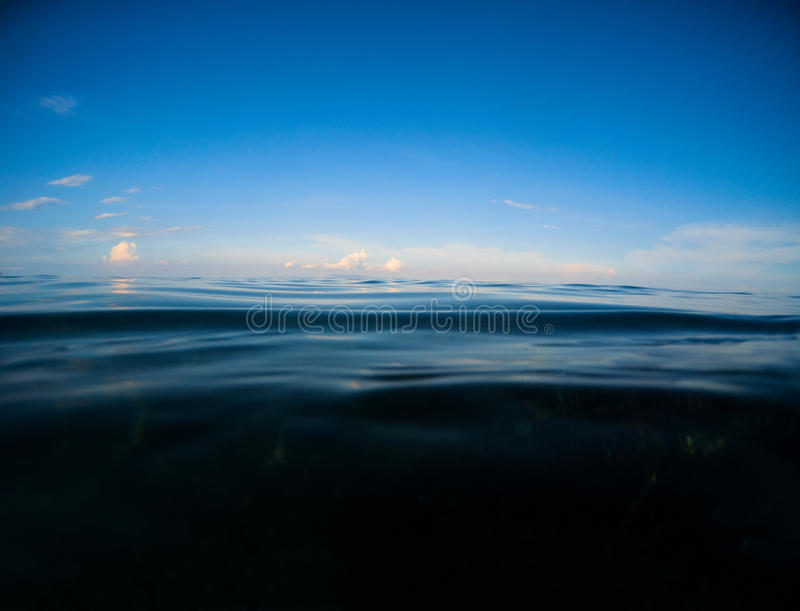 Dark sea and deep blue sky. Double landscape with sea water and sky. stock images