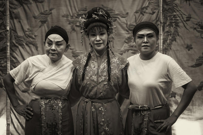 Dark sepia version of team members of Chinese Teochew opera troupe royalty free stock photo
