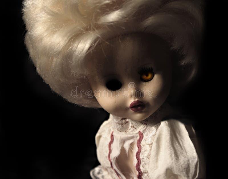 Dark series - vintage spooky doll stock image