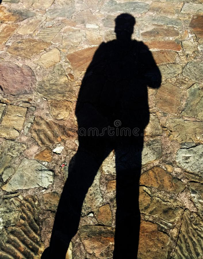 Dark Shadow of a Person. In sunlight stock photography