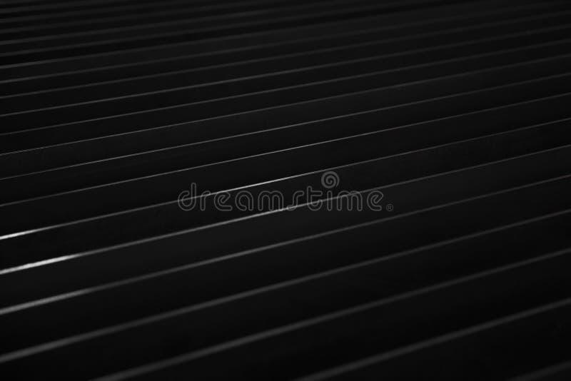 Dark sheet metal backdrop. Detail of the dark sheet metal backdrop stock photo