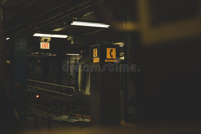 Dark shot of a telephone booth in a subway station. A dark shot of a telephone booth in a subway station stock photo