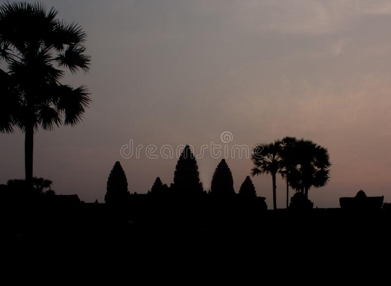 A dark silhouette of Angkor Wat temple during a sunrise near Siem Reap in Cambodia royalty free stock photo