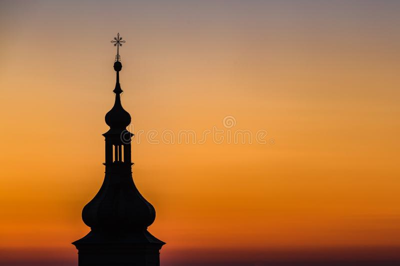 Dark silhouette of church tower of Our Lady Victorious royalty free stock image