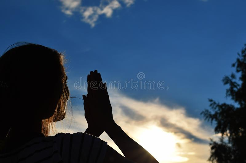 Pleasant leisure in summer. Silhouette of  beautiful girl stock photo