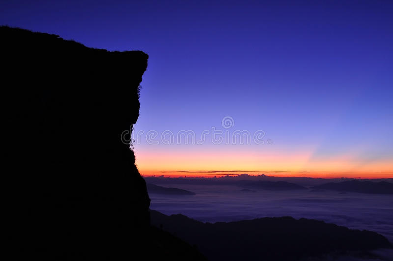 Dark Silhouette of mountain on sunrise scene. And sea of fog in early morning, Chiang Rai, Thailand royalty free stock image
