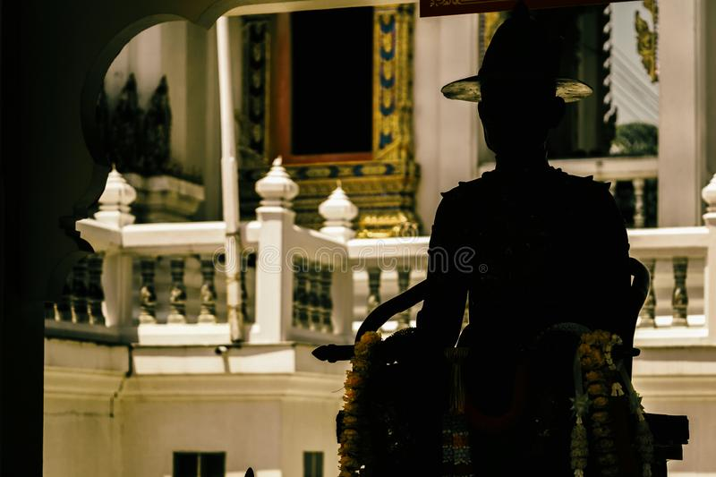 The dark silhouette of the statue of a Thai soldier royalty free stock photo