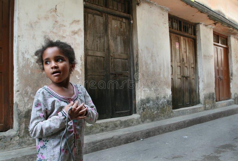 Dark-skinned African Muslim girl 10 years old, Tanzania, Zanzibar island. stock photos