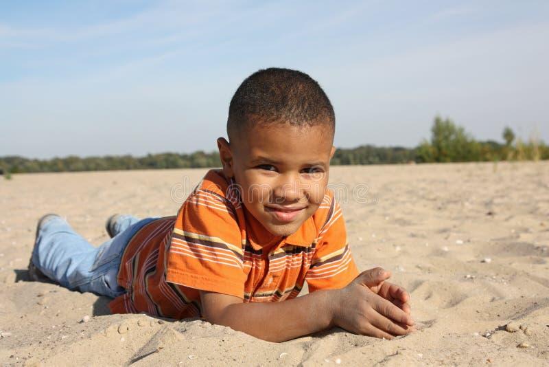 Dark-skinned boy stock photos