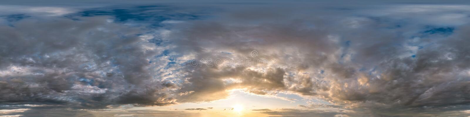 Dark sky before sunset with beautiful awesome clouds. Seamless hdri panorama 360 degrees angle view  with zenith for use in 3d. Graphics or game development as stock images