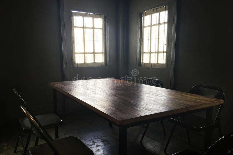 Dark small room with table and chair Concept. Dark small room with table and chair royalty free stock image