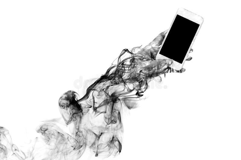 Dark smoke shaped like a hand holding a mobile phone. stock images