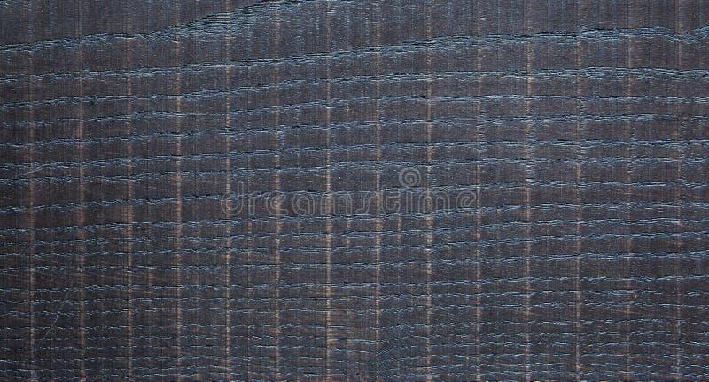 Dark sneed ruwweg Houten textuur stock afbeeldingen