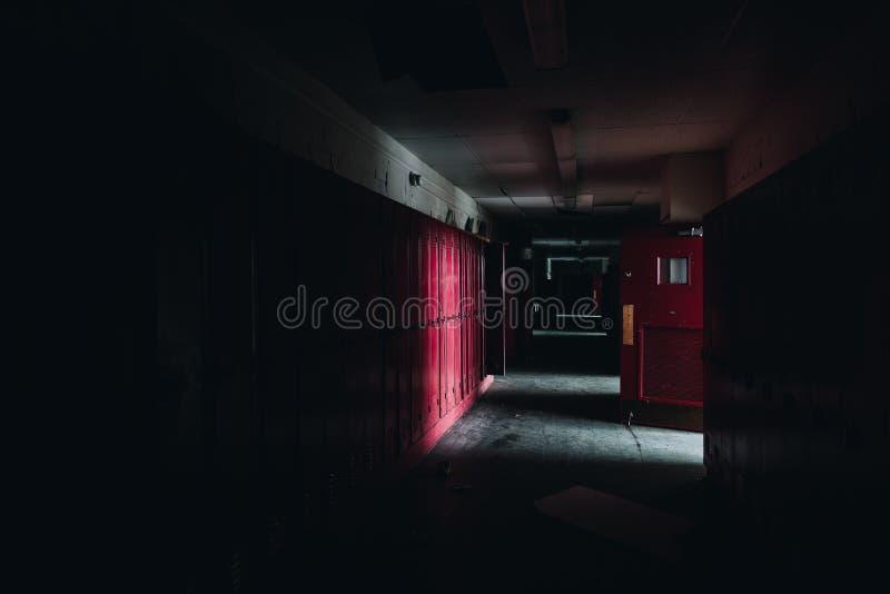 Dark, Spooky Hallway + Red Lockers - Abandoned Gladstone School - Pittsburgh, Pennsylvania fotografering för bildbyråer