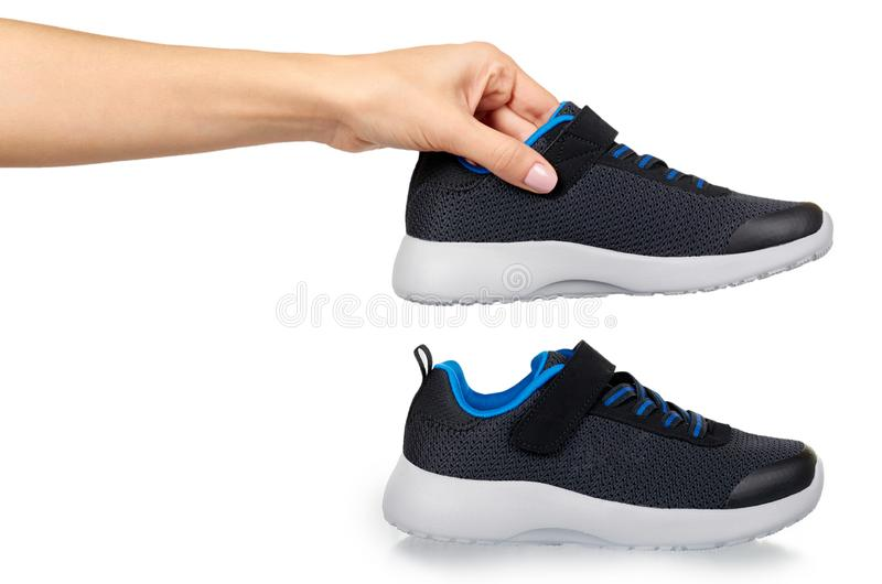 Dark sport shoes for running. Kids foot wear stock images