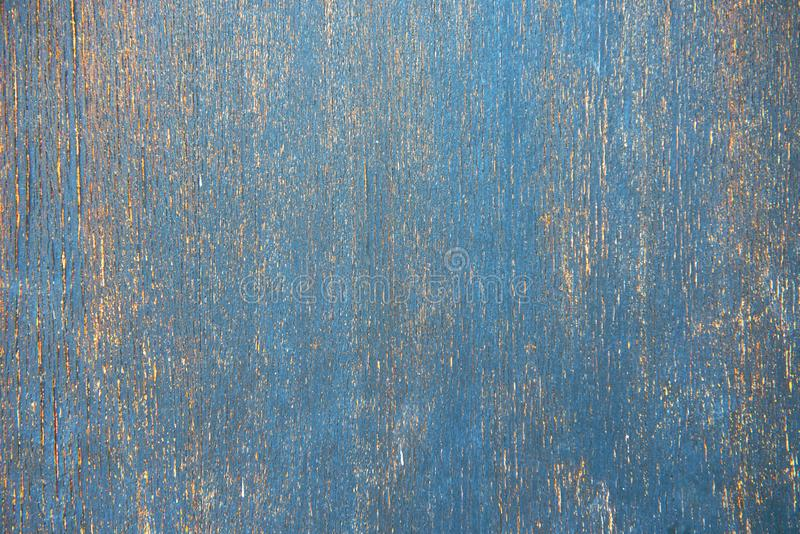 Dark stained blue teal reclaimed wood surface with aged boards lined up. Wooden planks on a wall or floor with grain and texture. Stained vintage wood stock images