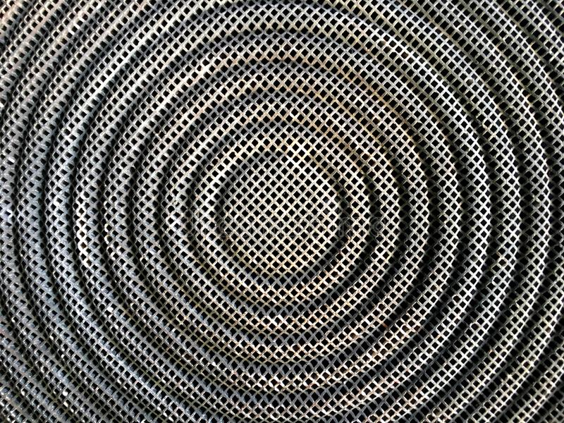 Dark Stainless steel mesh texture in circle shape background of stove. Dark Stainless steel mesh texture in circle shape background of stove top view royalty free stock photography