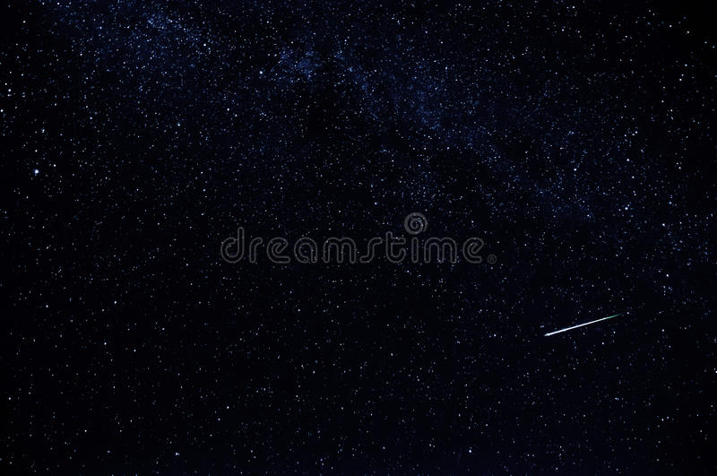 Dark starry sky with falling star and the milky way royalty free stock photography