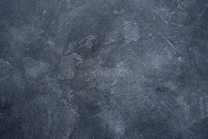 Dark stone or slate wall. stock images