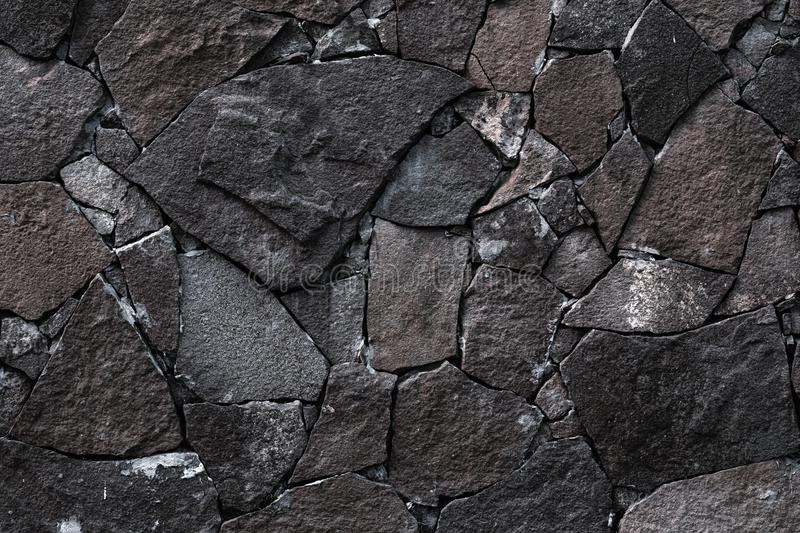 Dark stone wall background. Grey rock texture in retro style. Brick wall backgrounds. Abstract pattern. Gray stones, textured surf. Ace, natural backdrop stock photos