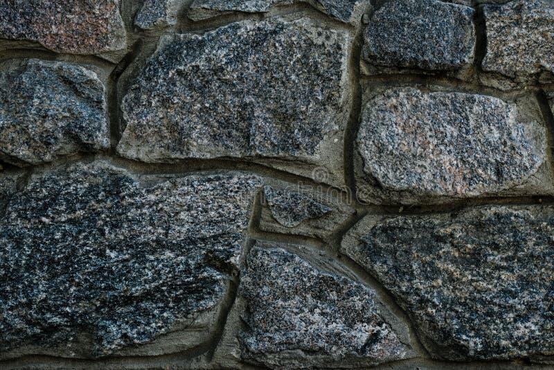 Dark stone wall texture. Stone wall background. Dark rock pattern texture. Granite pattern of natural background. stock image