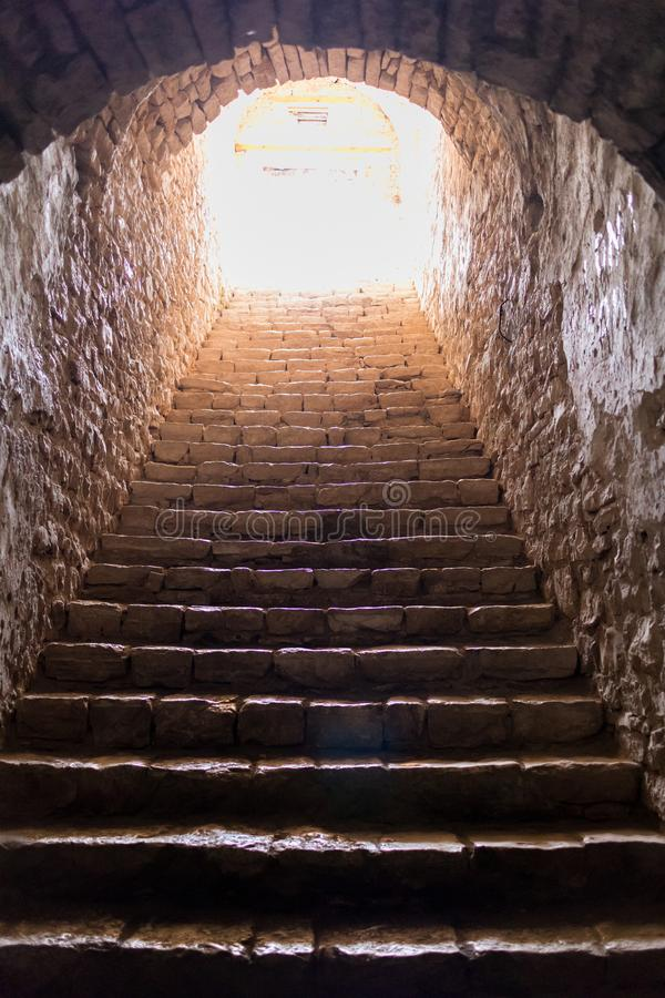 Dark, stony steps in Palermo Castle stock image