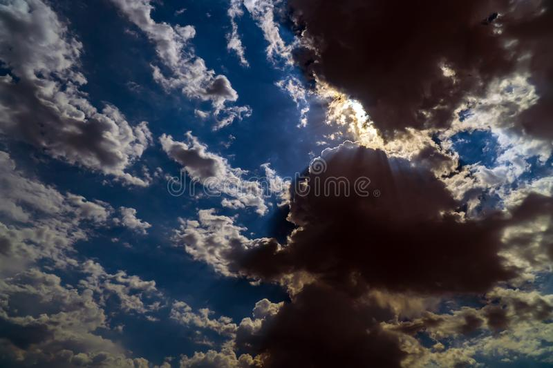 Dark storm clouds on a bright blue sky stock photography