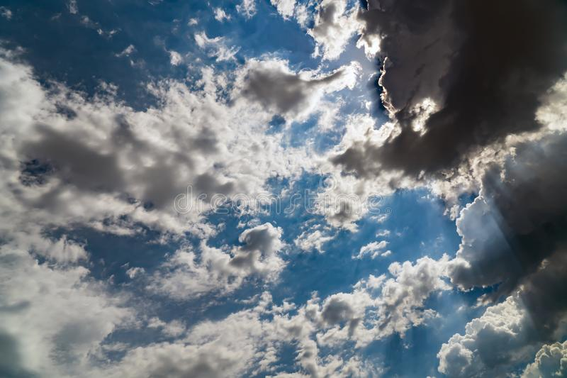 Dark storm clouds on a bright blue sky royalty free stock images