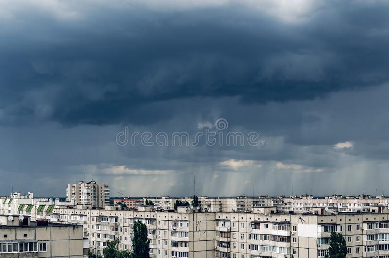 Dark storm clouds over houses, bad weather in the city.  royalty free stock photography