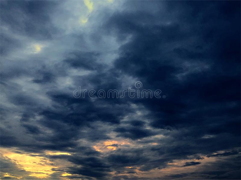 Storm clouds with peaks of sunrise stock photography