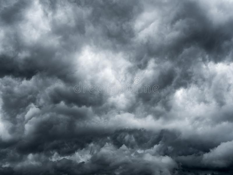 Dark storm clouds before rain. Background of storm clouds before a thunder-storm stock photography