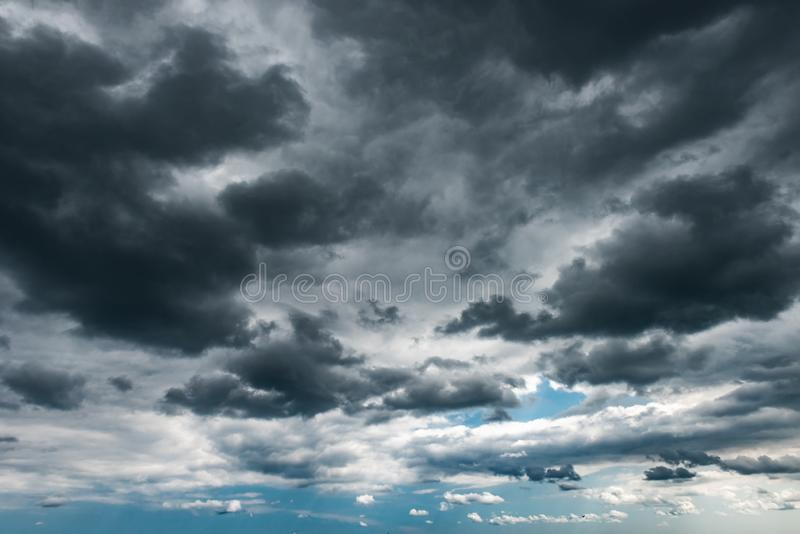 Dark storm clouds on the sky stock image
