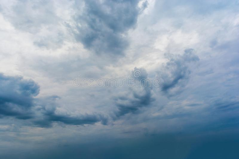 Dark storm clouds in the sky. Blurring background. Bright colors stock photography