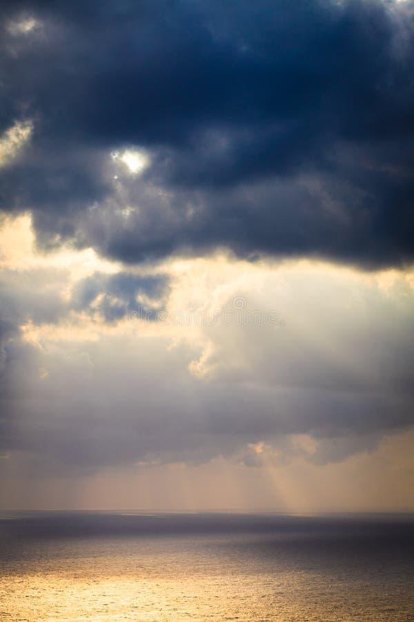 Dark storm rainy clouds on sea stock photo