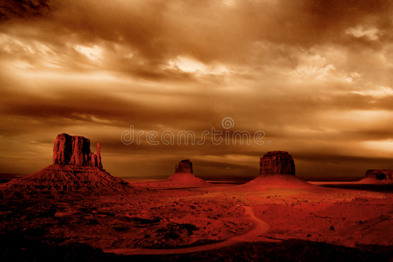Dark storms. Hovering at Monument Valley stock photos