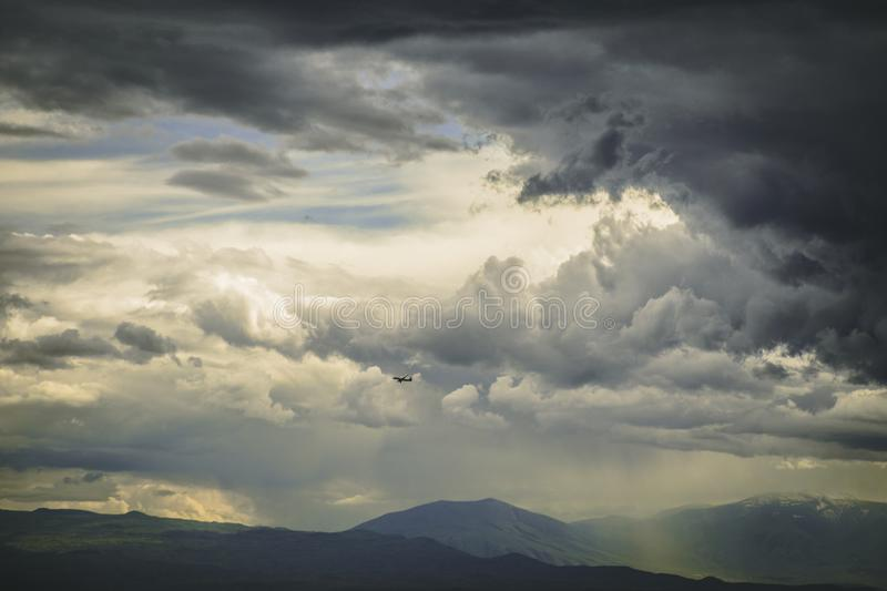 Dark stormy clouds. Bug beautiful dark stormy clouds stock images