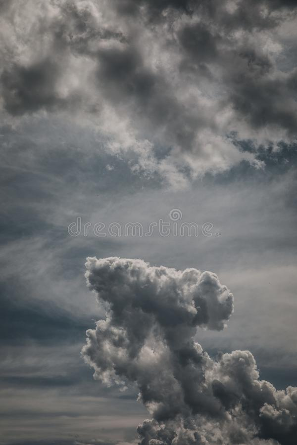 Dark stormy clouds. Bug beautiful dark stormy clouds royalty free stock image