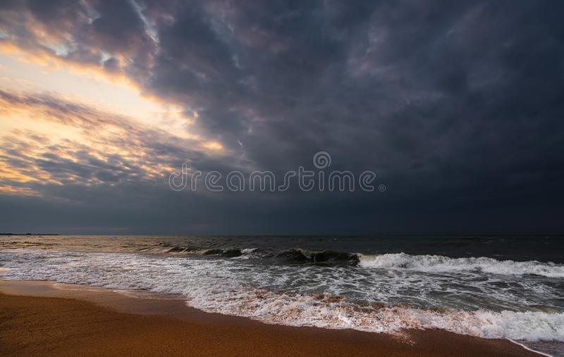 Dark stormy sea and empty beach stock images