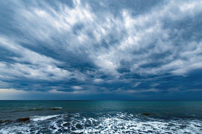 Dark stormy sky above the ocean. stock image