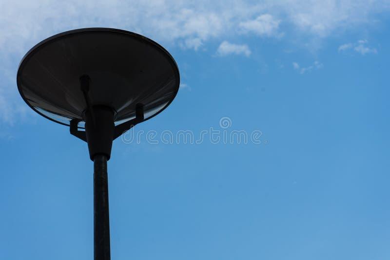 Dark street light isolated with cloudy blue sky royalty free stock photos