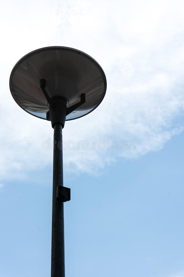 Dark street light isolated with cloudy blue sky royalty free stock images