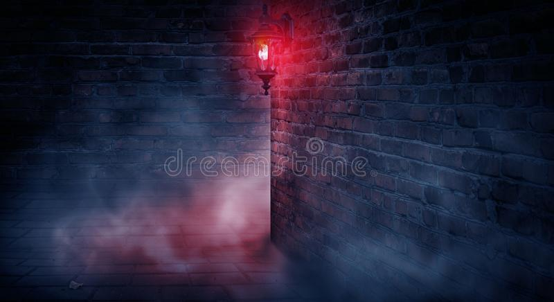 A dark street, a red lantern, a brick wall, smoke, a corner of the building, a lantern shining. Night scene, club neon light. Night city and neon light stock images